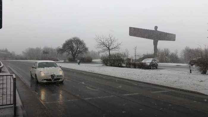 Weather warnings in place as parts of UK blanketed in snow