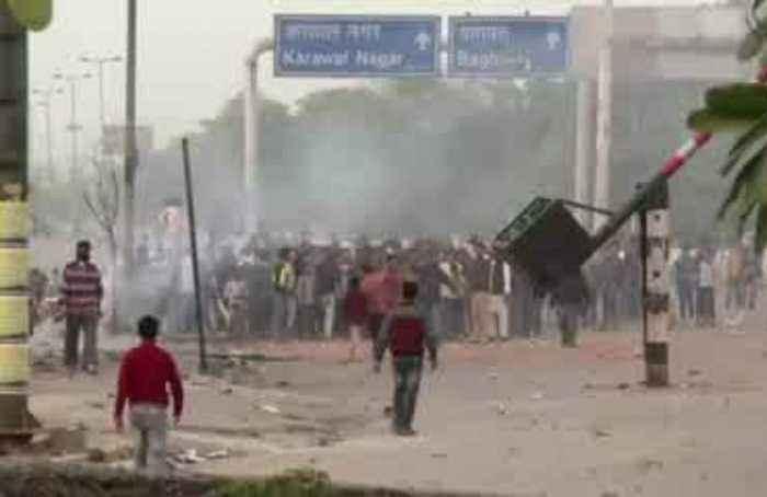 7 killed, 150 injured: Indian riots overshadow Trump visit