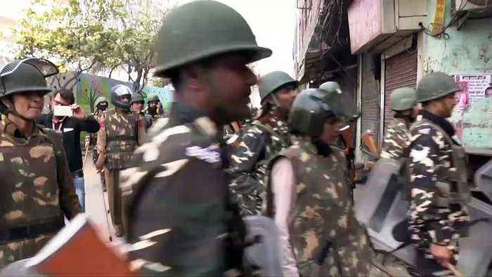 Thousands of paramilitary police deployed in New Delhi after deadly riots