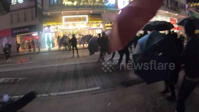 Hong Kong protesters throw molotovs and 'funeral money' in Mongkok