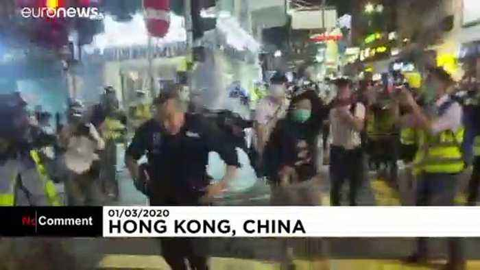 Protesters clash with police at subway incident commemoration