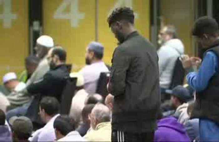 Flowers and messages of support adorn NZ mosque for shooting anniversary