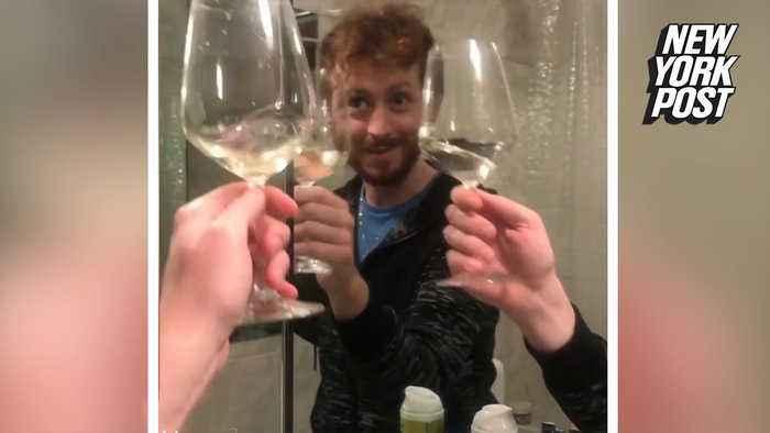 Guy cheers himself in mirror in funny quarantine video