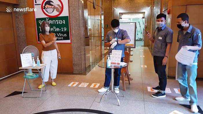 Office workers screened for COVID-19 in Bangkok as country declares 'state of emergency'