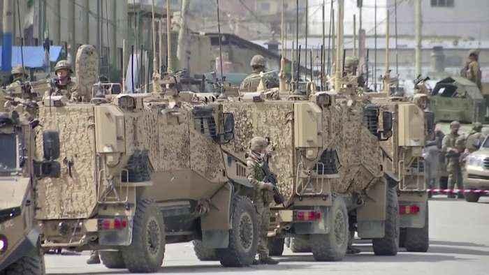Gunmen in Afghanistan kill dozens in raid on Sikh complex