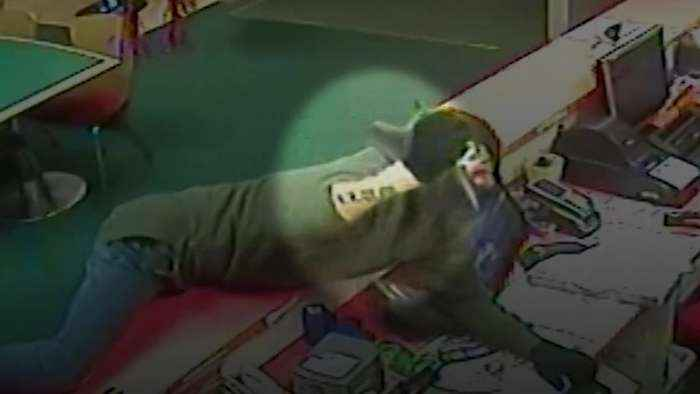 Masked robber caught out by his forearm tattoo