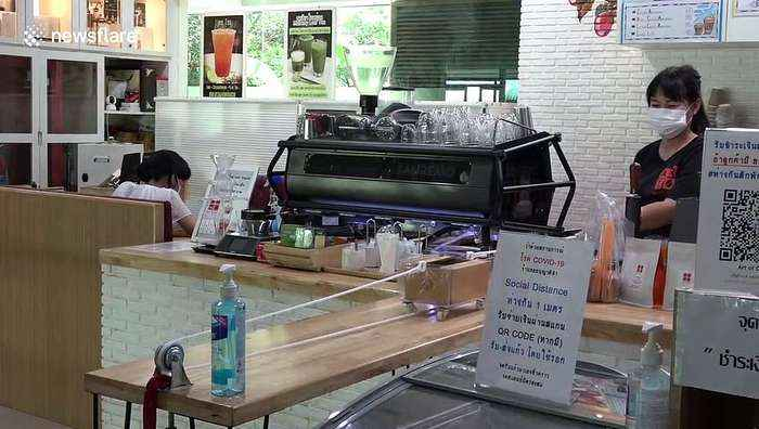Thai coffee shop uses pulleys to follow social distancing rules while serving customers