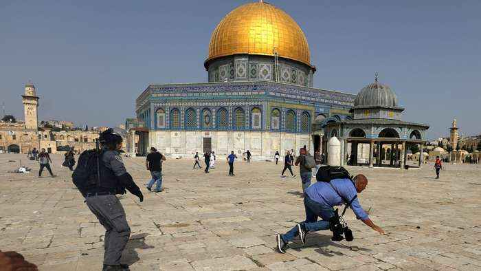 Dozens wounded as Israeli forces raid Al-Aqsa compound