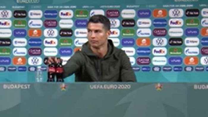 Ronaldo pushes Coke bottles aside to drink water