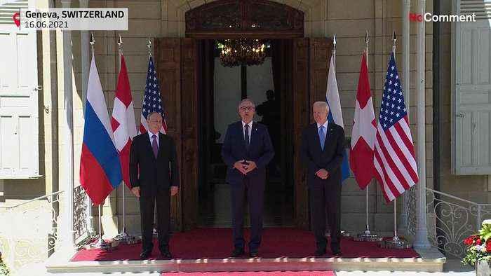 Biden and Putin shake hands at summit venue