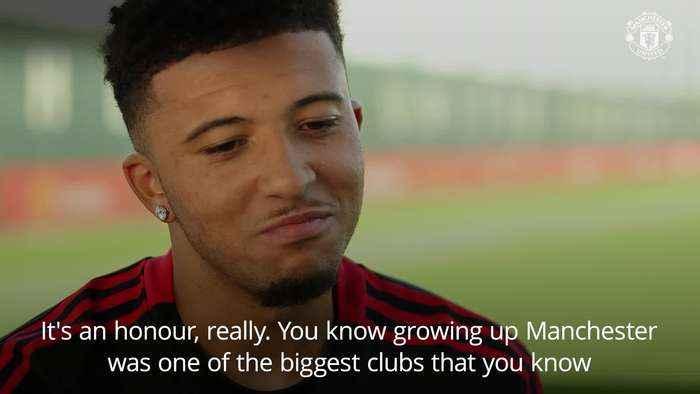 Jadon Sancho 'honoured' to sign for Manchester United