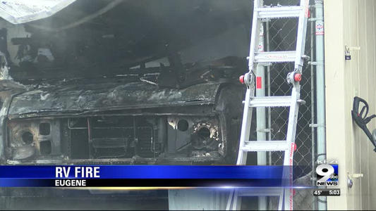 Fire destroys rv and parking structure one news page video for Rv covered parking structures