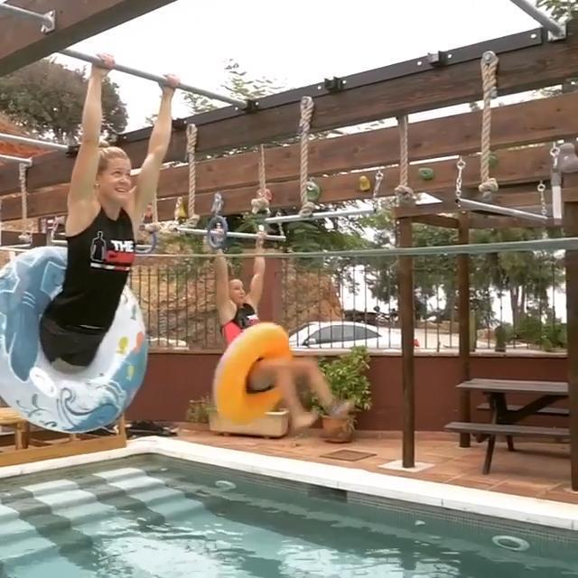 Two Girls Climb Monkey Bars Over Swimming Pool One News Page Video