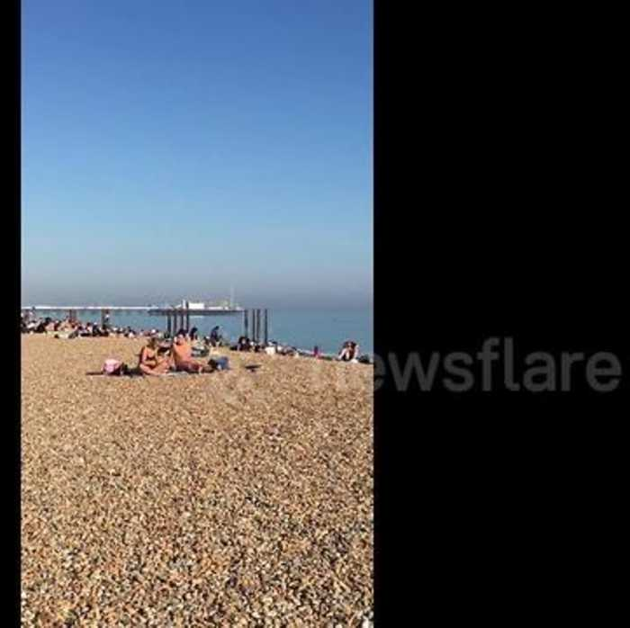 News video: People in Brighton head to the beach on hottest day of the year