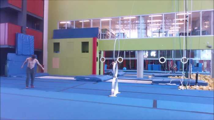 News video: Guy Shows off Agility by Jumping Through Rings