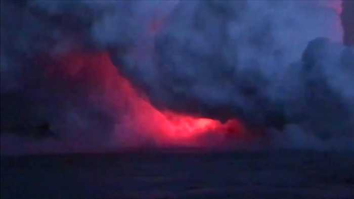 Passenger captures moment 'lava bomb' strikes boat in Hawaii