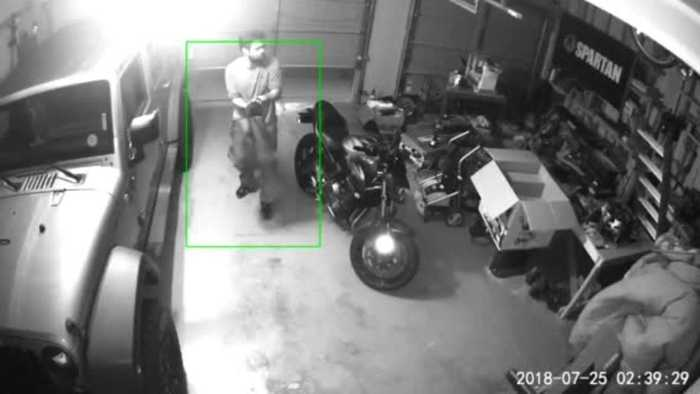 Suspect caught on camera crawling into garage, stealing items in Aurora