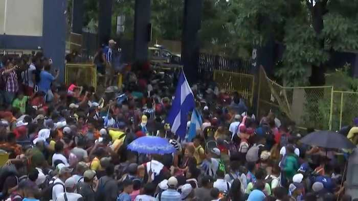 RAW: Mexico Border Gate Torn Down As Migrant Caravan Heads North Towards US