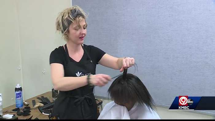 Teacher inspiring self confidence with hair cuts for students for Christmas