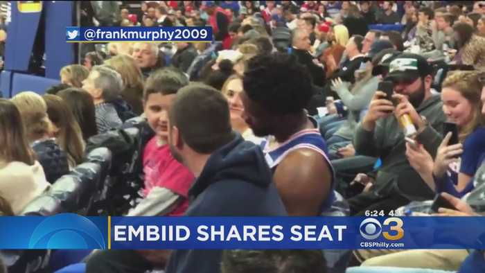 Young Fan Shares Seat With Joel Embiid