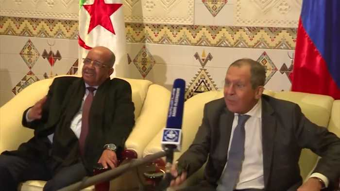 Russia's Lavrov offers hearty handshake to microphone