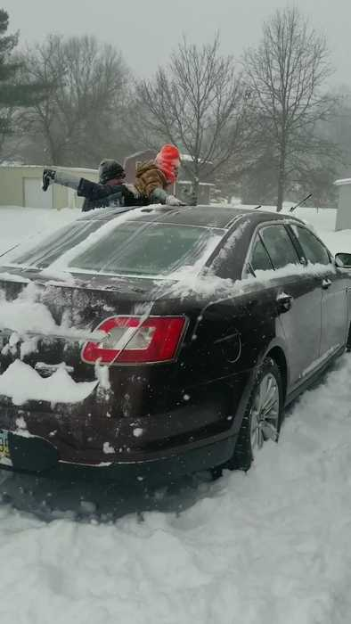 Dad Uses Son to Clean Snow Off Car