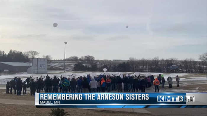Paper lanterns released to honor sisters killed in crash