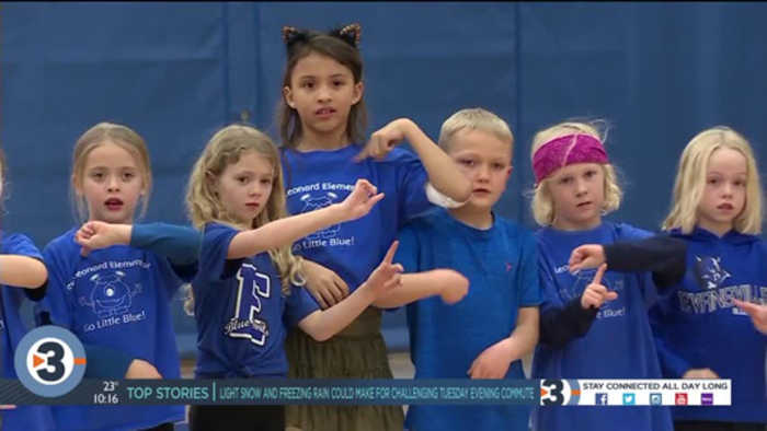 First grade class does anthem in ASL after learning it to support classmate who is hard of hearing