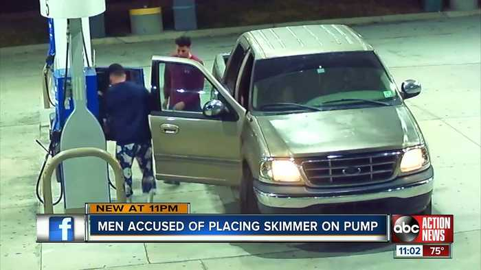 Tampa Police search for two men caught on video allegedly placing skimmer device at gas pump