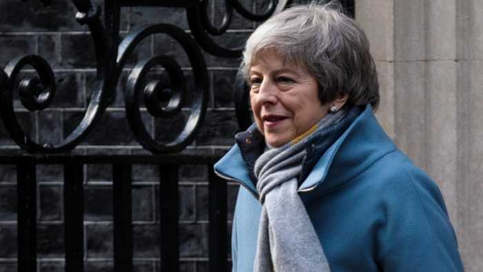 May Clings to Brexit Deal as Parliament Votes for a Delay