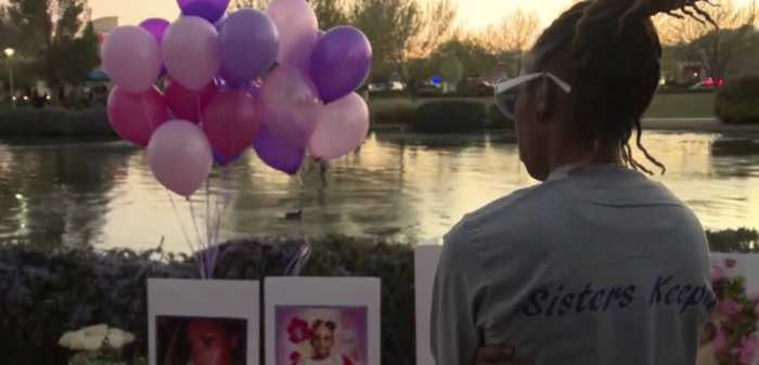 Candlelight vigil for mother, daughter