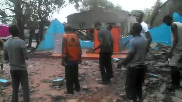 Worshippers sing in church destroyed by cyclone Idai