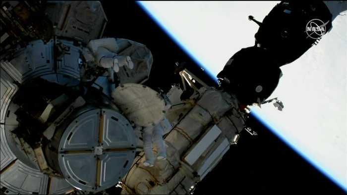 Astronauts take first steps into space