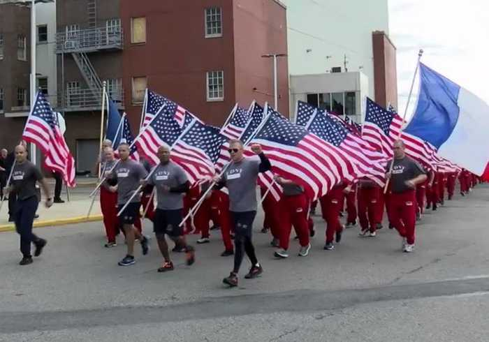 New York Firefighters Run With French Flags In Tribute to Note Dame Crews
