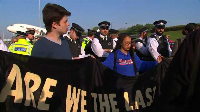 Weeping teenagers stage climate protest near Heathrow Airport