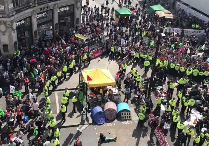 Police Lines Cordon Off Extinction Rebellion Protesters in London's Oxford Circus
