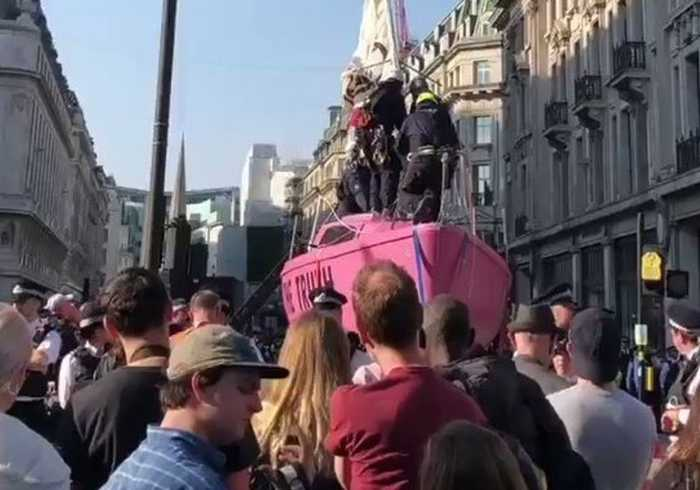 Authorities Work to Remove Pink Boat From London's Oxford Circus During Extinction Rebellion Protest