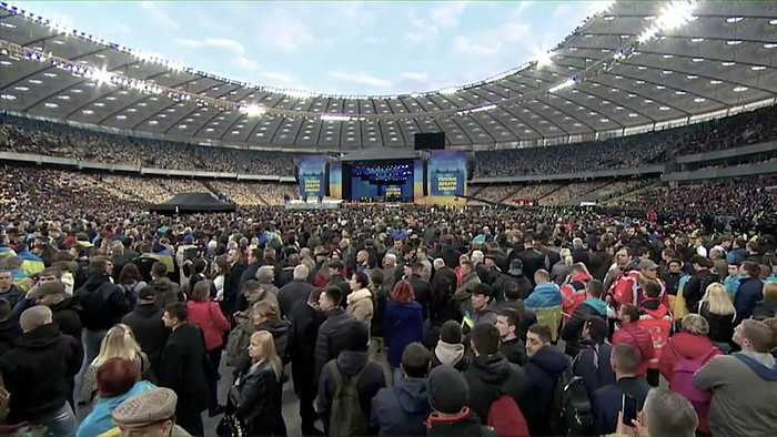 Ukraine election: presidential candidates trade barbs in stadium debate