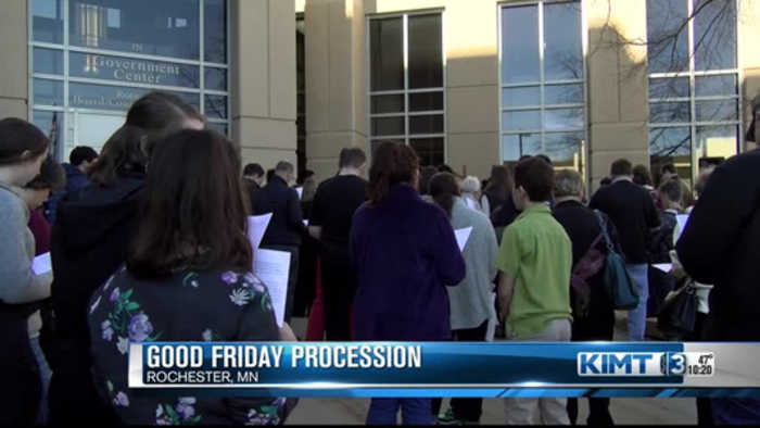 People gather for a Good Friday procession