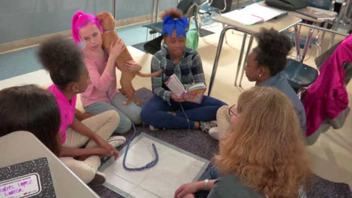 East Lake Academy Students Read To Dogs
