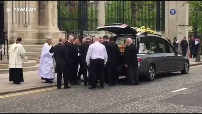 Murdered journalist Lyra McKee's coffin carried into Belfast's St Anne's Cathedral