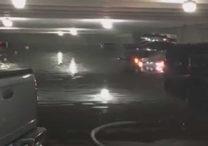 Texas Storms Leave Cars Flooded in Dallas Airport Garage