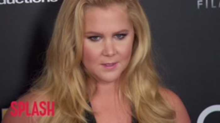 Amy Schumer Confirms She Is 'Still Pregnant And Puking'