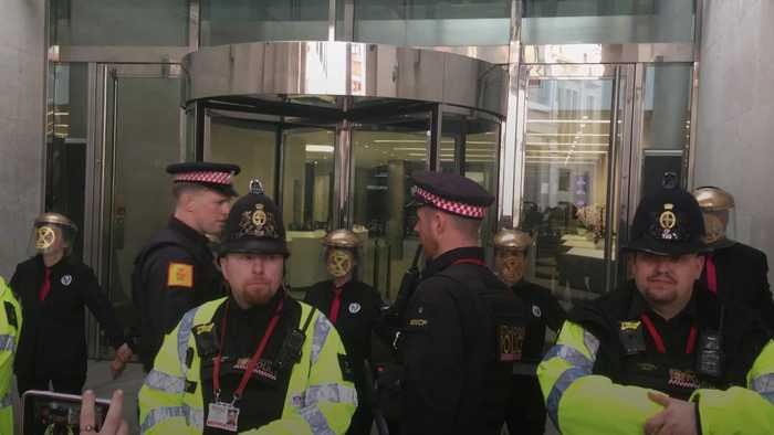 Climate protesters glue themselves to London Stock Exchange
