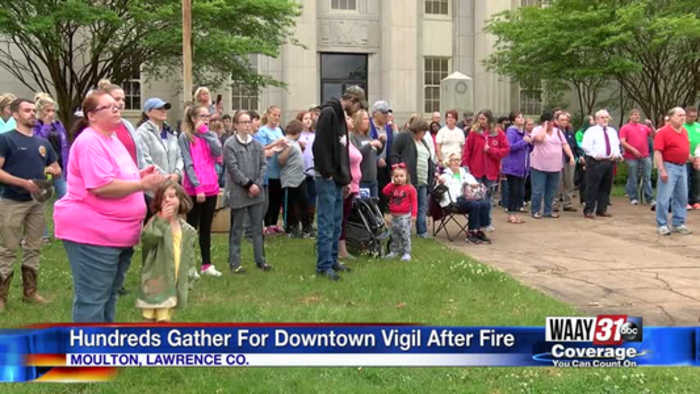 Hundreds gather for downtown vigil after fire