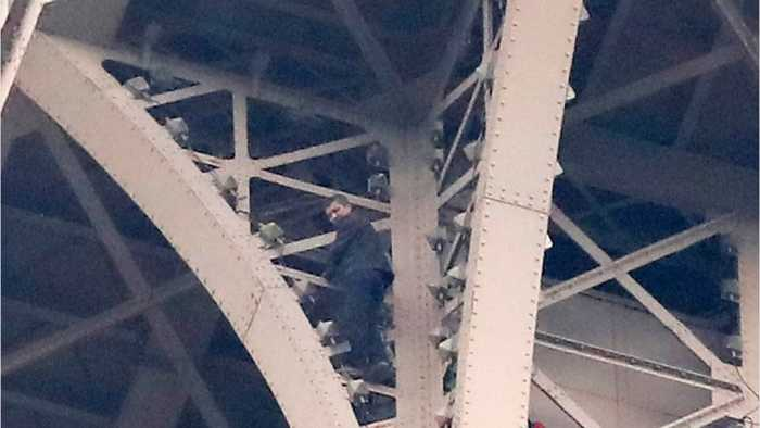The Eiffel Tower shut down and evacuated after a man was spotted climbing the structure