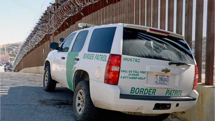 U.S. border agent accused of slurs before bumping migrant with truck