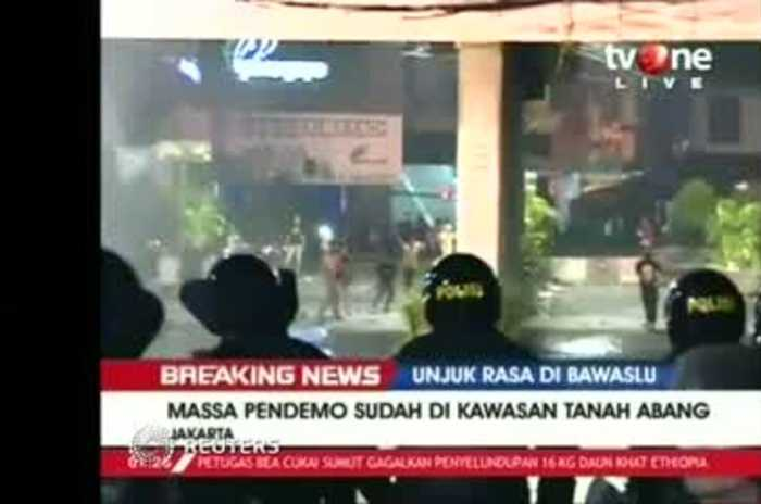 Indonesian police fire teargas on protesters
