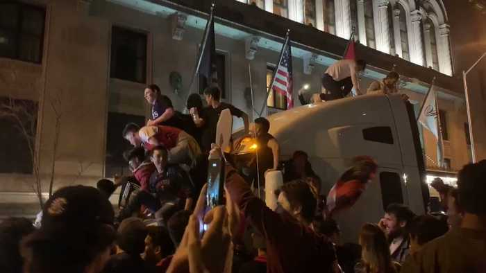 Fans Climb on Truck After Toronto Raptors Victory