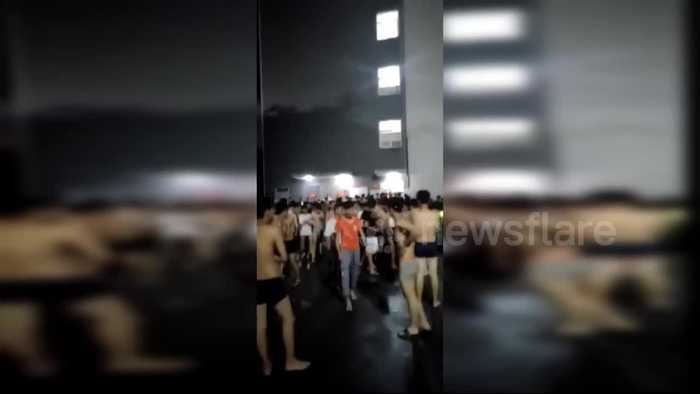 Shirtless residents flee out of buildings after 6.0-magnitude earthquake hits China's Yibin